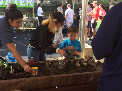 Ag Students planting seeds with kids—FreshPoint Central California