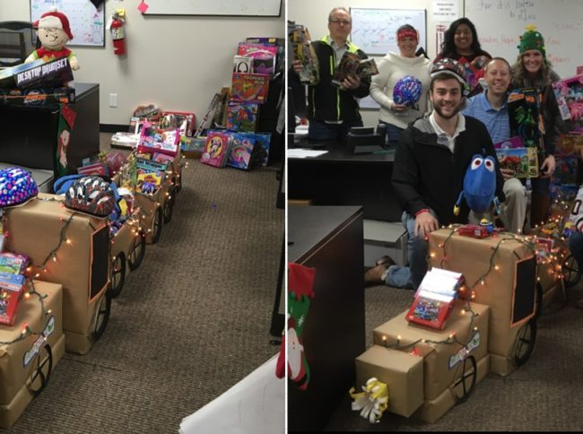 FreshPoint Dallas' retail team having fun with their holiday train display of 99 toys donated to The Family Place.
