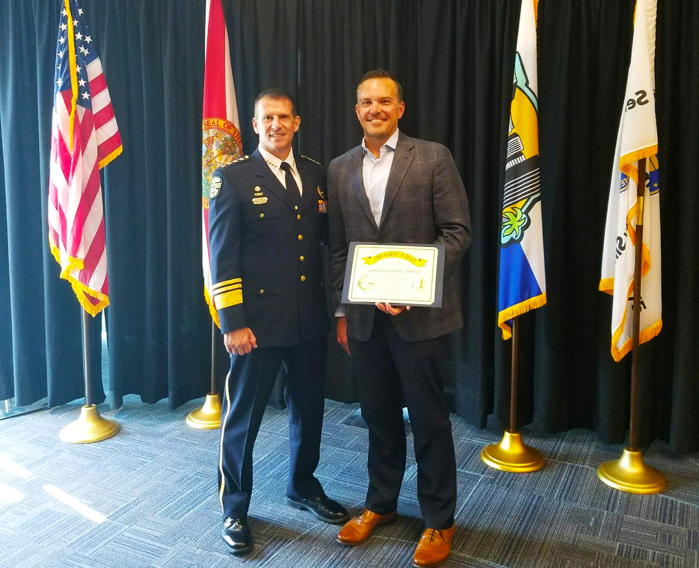 FreshPoint Central Florida Preston Fletcher receiving the Good Citizenship Award from The Orlando Police Department.