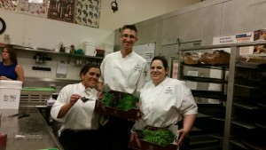 Chef Peter and the chefs of the Loews Portofino Bay Hotel garde manger team. Chef Peter likes to work with oddities and specialties with his team for beautiful plate ups. They are holding a box of sakura living greens and were happy to taste test the greens and use them the spot for plate ups!